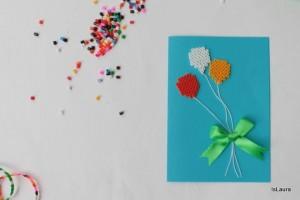 Biglietto d'auguri con perline a forma di palloncino